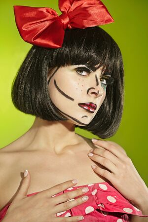 mimo: Portrait of funny mime girl with a theatrical makeup and red bow in a polka-dot dress