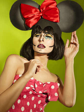 mimo: Portrait of funny comic actress in a theatrical makeup in a cap of a mouse