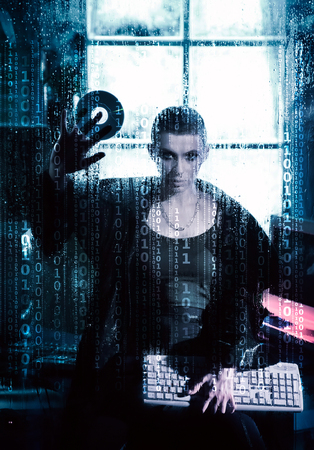 Female hacker working on a code with digital interface around