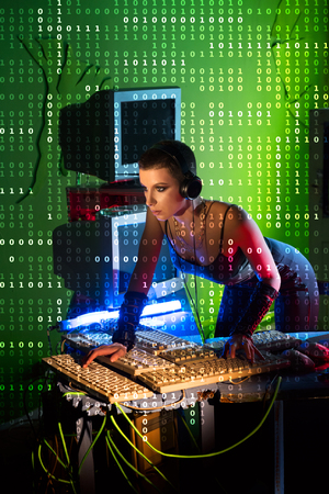 Female hacker working on a code with digital interface around Imagens
