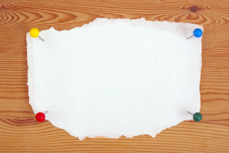 torn edges: the clean sheet of paper with torn edges on a board