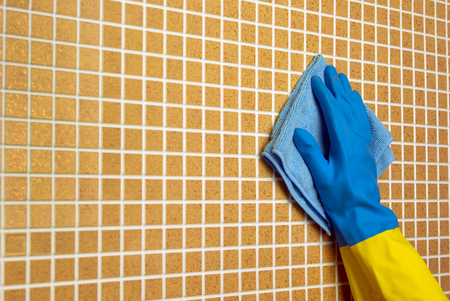 hand rubbing: blue cloth with a yellow and blue gloves on a brown cells