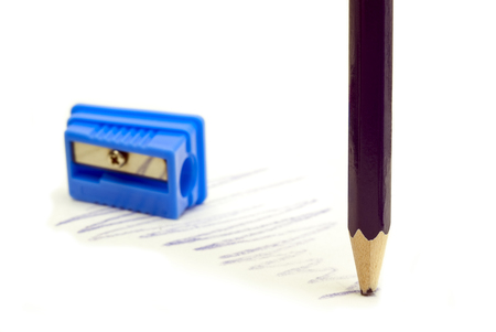 dull violet pencil blue pencil sharpener on a white background