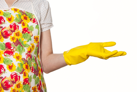female torso wearing a white shirt in the color apron hand in yellow glove on a white background Stock Photo