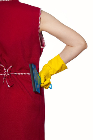 smock: female torso in a red smock hand in yellow glove with blue scraper Stock Photo