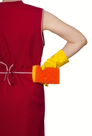 smock: female torso in a red smock hand in yellow glove with red sponge on a white background Stock Photo