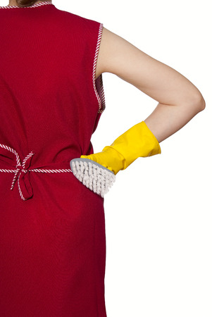 smock: female torso in a red smock hand in yellow glove with gray brush on a white background Stock Photo