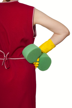 smock: female torso in a red smock hand in yellow glove with green sponge on a white background Stock Photo