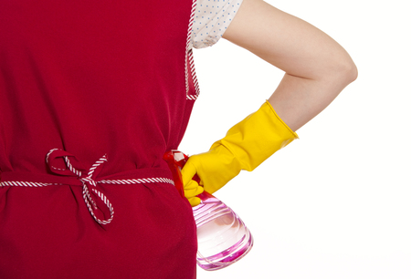 smock: female torso in a red smock hand in yellow glove with red spray on a white background