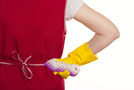 smock: female torso in a red smock hand in yellow glove with a violet brush on a white background Stock Photo