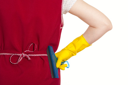female torso in a red smock hand in yellow glove with blue scraper Stock Photo