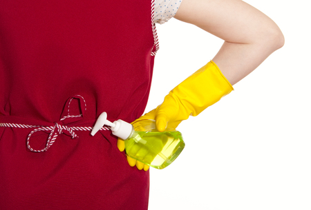 smock: female torso in a red smock hand in a yellow glove with the dispenser on a white background