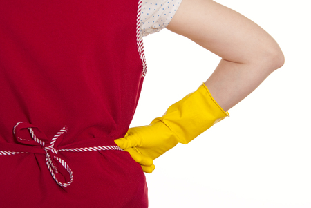 smock: female torso in a red smock hand in yellow glove a white background Stock Photo