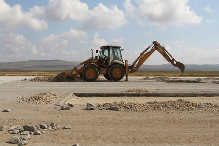 TULCEA, ROMANIA - NOVEMBER 08: Heavy construction equipment working on a runway as part of the Danube Delta international airport expansion plan on November 08, 2015 in Tulcea, Romania. Redakční
