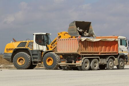 TULCEA, ROMANIA - NOVEMBER 08: Heavy construction equipment working on a runway construction site as part of the Danube Delta international airport expansion plan on November 08, 2015 in Tulcea, Romania. Editorial