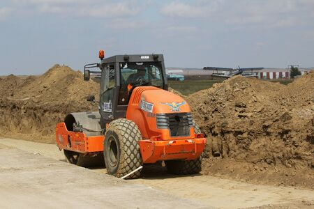 TULCEA, ROMANIA - SEPTEMBER 26: Heavy construction equipment compacting soil on a runway construction site as part of the Danube Delta international airport expansion plan on September 26,2015 in Tulcea, Romania.