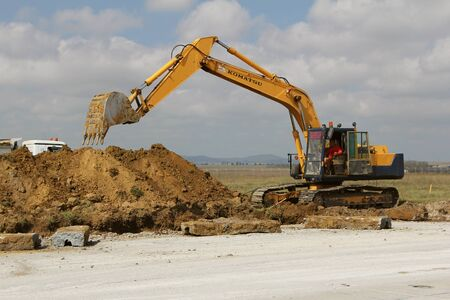 TULCEA, ROMANIA - SEPTEMBER 26: Crawler excavator working on a runway construction site as part of the Danube Delta international airport expansion plan on September 26,2015 in Tulcea, Romania. Editorial