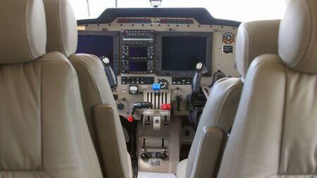 twin engine: TULCEA, ROMANIA - APRIL 27: Interior of a twin engine plane during a test flight over the international airport Danube Delta on April 27, 2015 in Tulcea, Romania