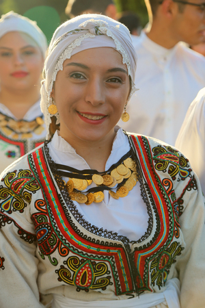 TULCEA, ROMANIA - AUGUST 08: Cyprus dancer in traditional costume at the International Folklore Festival for Children and Youth - Golden Fish on August 08, 2018 in Tulcea, Romania.