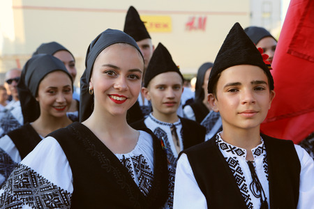 TULCEA, ROMANIA - AUGUST 08: Romanian group of dancers in traditional costumes at the International Folklore Festival for Children and Youth - Golden Fish on August 08, 2018 in Tulcea, Romania.
