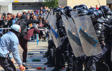 TULCEA, ROMANIA - APRIL 28: Protesters clash with riot gendarmerie during a riot-control exercise on April 28, 2017 in Tulcea, Romania Редакционное