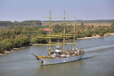 Tulcea, Romania - 15 September 2019: Training ship Mircea sailing on the Danube, aerial view. Mircea is a A-class, bark type sailing vessel with three masts. Редакционное