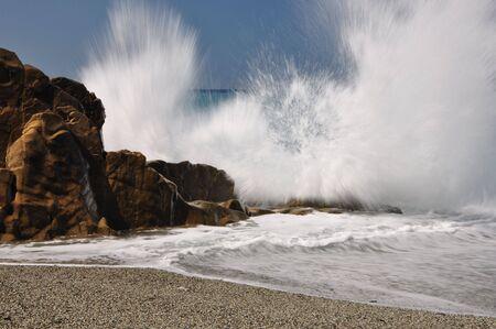coastline: Big waves hit rocks in Mediterannean Sea Stock Photo