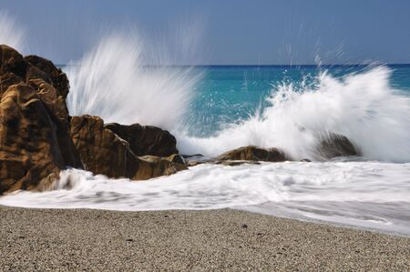 stormy: Big waves hit rocks in Mediterannean Sea Stock Photo
