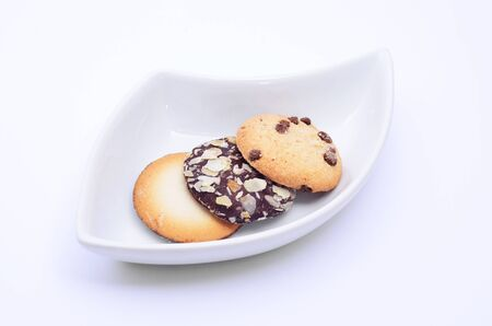 Delicious cookies and biscuits on white plate and white background Stock Photo
