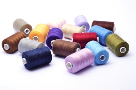 Colored bunch of sewing rolls on white background
