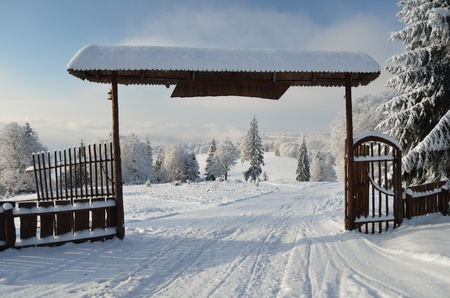 Beautiful nature park entrance in winter time Stock Photo