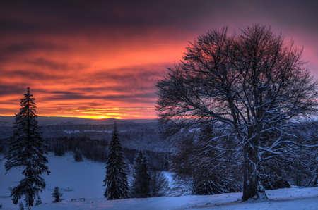 Beautiful sunset in winter mountain landscape