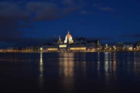 Budapest parliament building on the Danube banks at night