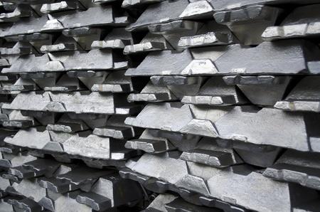silver ingots: Stack of raw aluminium ingots in aluminium profiles factory Stock Photo