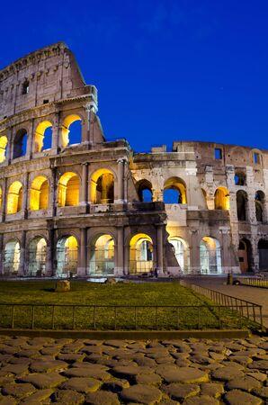 Ancient roman colosseum at dusk, Rome, Italy Stock Photo