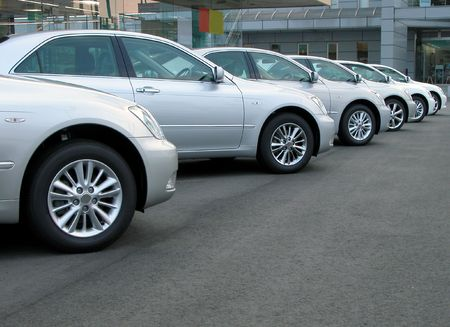 Cars row in front of a cars shop