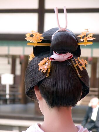 Close up of an interesting and unusual geisha hairdo photo