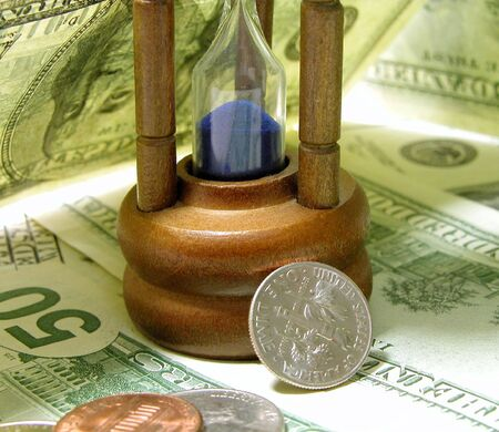 time: hourglass and shadows...money:the bills...interesting objects and lighting business composition Stock Photo - 468169