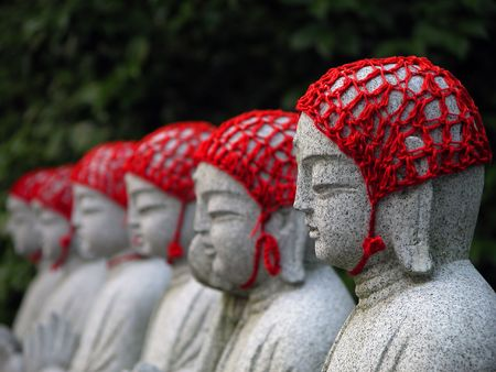 japanese temple: Row of Buddhist statues in a Japanese temple. Selective focus.