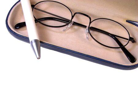 ballpen:   Glasses and ball-pen over white background Stock Photo
