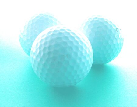 three golf balls and an interesting lighting.......great image for a golf tournament promotion.