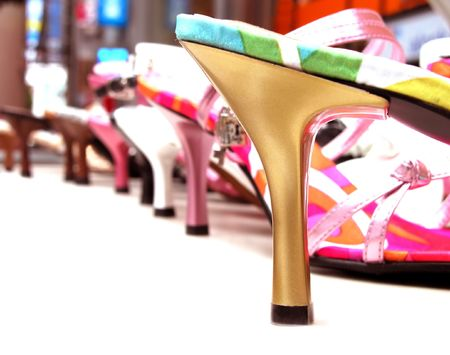 Woman shoes stand with selective artistic doff. Stock Photo