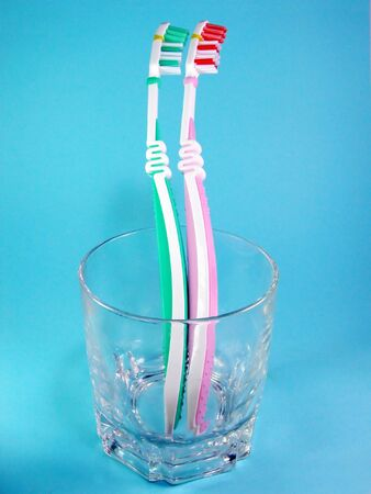 buccal:  Toothbrushes in a glass Stock Photo