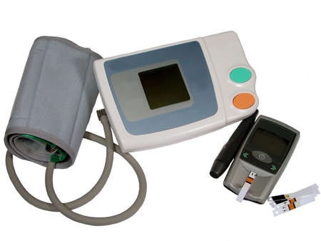 hypotension: Electronic tensiometer and glucometer  over white;automonitoring medical concept Stock Photo