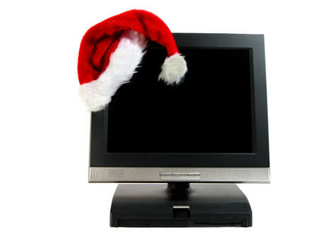 Santas hat on a desktop computer isolated over white