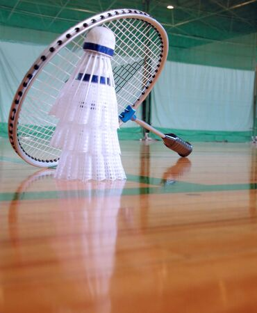 shuttlecock: Perspective in a sports hall with shuttlecocks and badminton racket