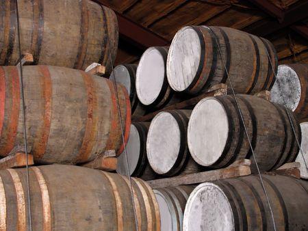 distillery: Whisky barrels stacks in a distillery cellar.