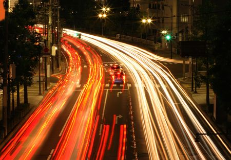 urbanscape:  Colourful motion blur abstract on a city road during the night-Sendai, Japan. Stock Photo