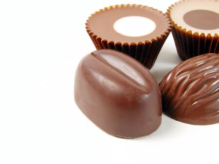 Chocolates over white with few shadows photo