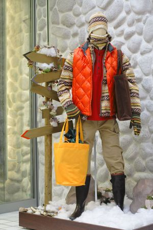 specific: Male mannequin wearing seasonal clothes in a specific environment